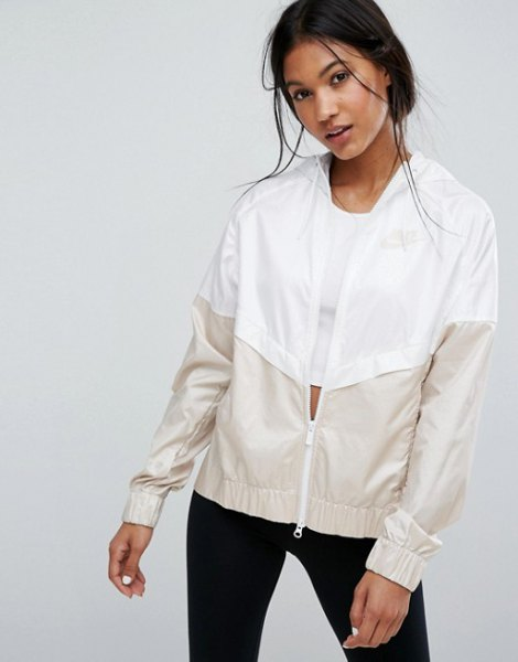 white and light pink color block windbreaker with black skinny jeans