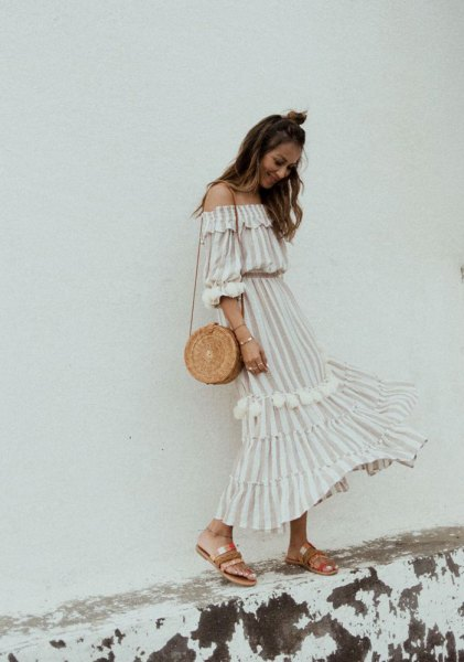 white and pale pink striped long dress with shoulder ruffles