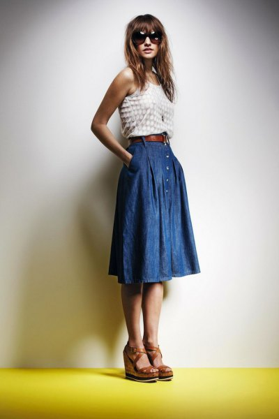 white and pink dotted vest top with blue pleated knee-length denim skirt