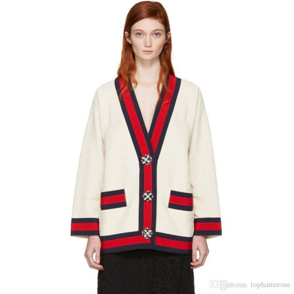 white and red knitted sweater with black midi skirt