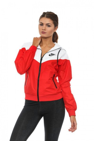white and red windbreaker with black skinny jeans