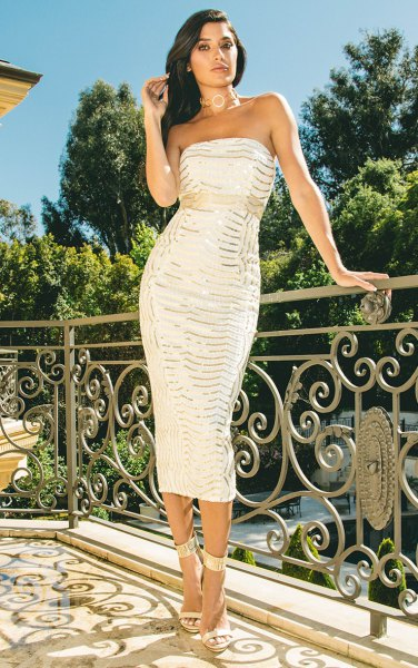 white and silver figure-hugging midi dress made of sequins