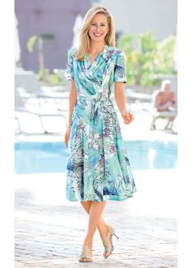 white and turquoise dress with short sleeves and midi belt and floral pattern