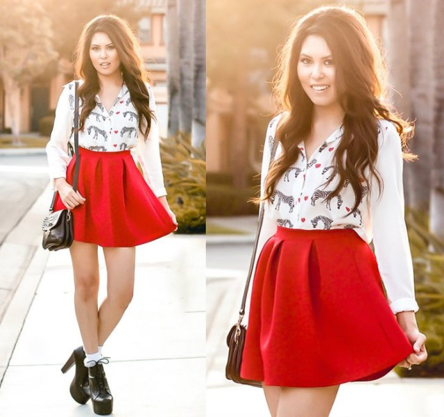 white blouse with animal motif and high-waisted red skater skirt