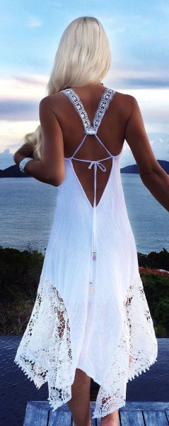 long summer dress made of white backless crochet lace