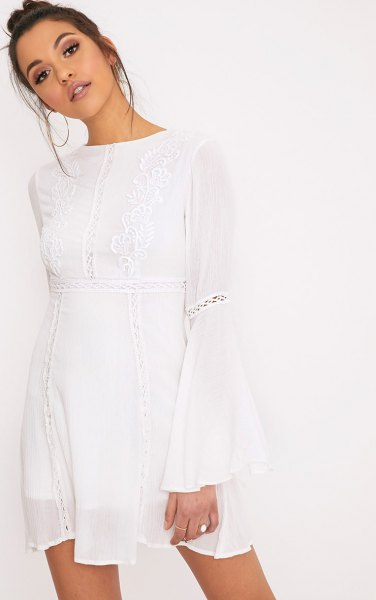 white airy dress with bell sleeves