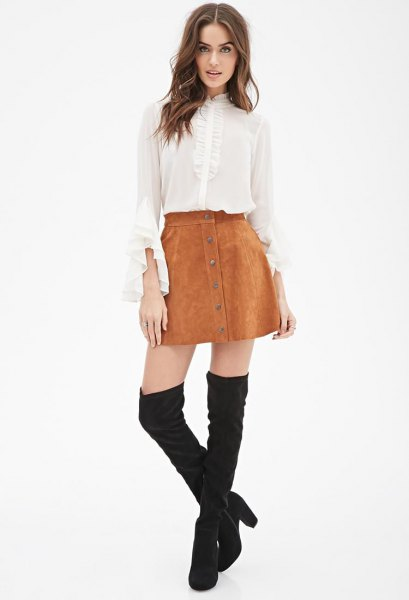 white chiffon blouse with bell sleeves, mini suede skirt and overknee boots