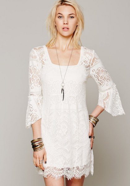 white lace shift dress with bell sleeves