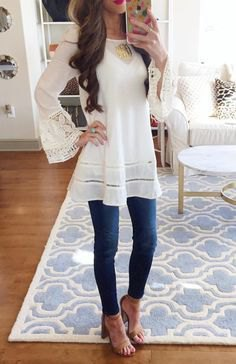 white long tunic blouse with bell sleeves and sandals