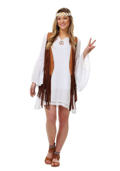 white shift dress with bell sleeves and black hippie vest