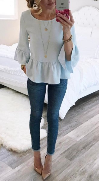 white blouse with ruffles and bell sleeves