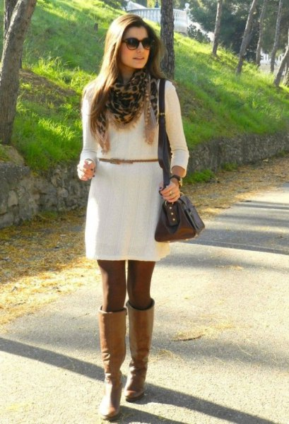 white dress with belt and knee-high camel leather boots