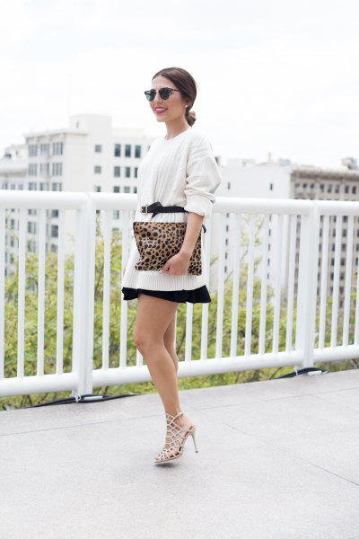 white oversized pullover with belt and minirater skirt