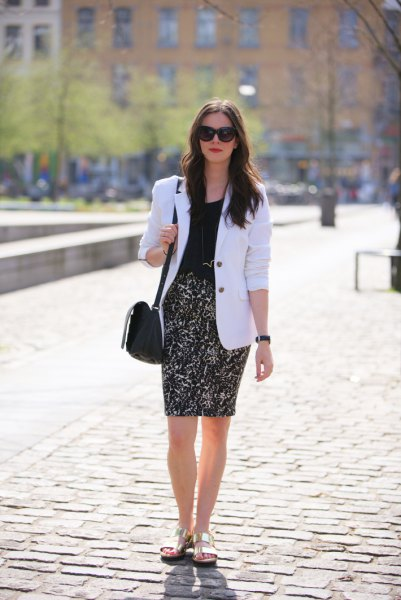 white blazer with black blouse and figure-hugging skirt with high waist