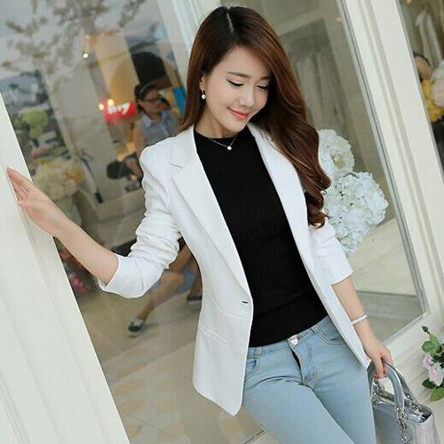 white blazer with black sweater with round neckline and light blue jeans
