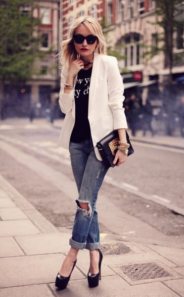white blazer with black printed t-shirt and ripped jeans