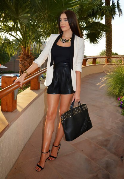 white blazer with black tank top with scoop neckline and heels with ankle straps