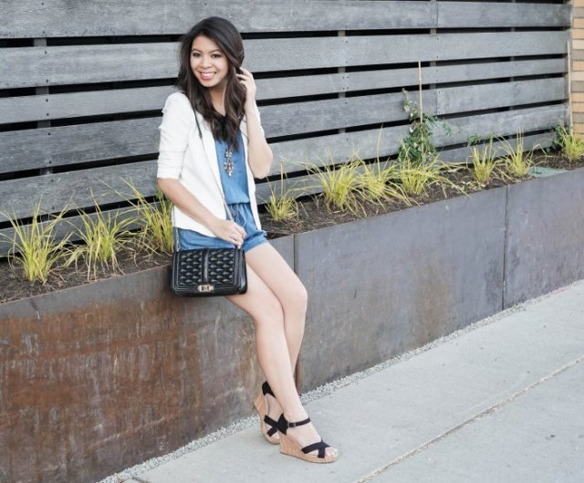 white blazer with blue mini-shorts and black lace-up sandals
