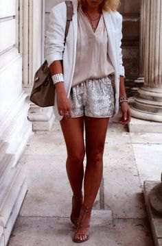 white blazer with a blushing pink blouse and shiny shorts