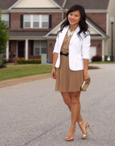 white blazer with a blushing pink mini pleated skirt and gold heels