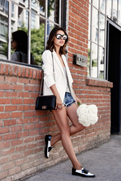 white blazer with short jeans and black and white evening shoes