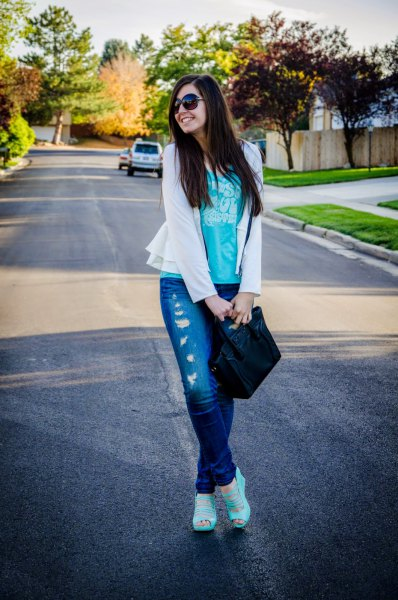 white blazer with gray tank top and ripped jeans
