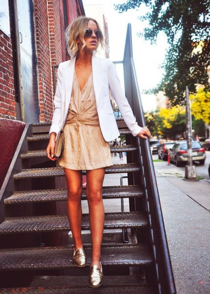white blazer with mini gold lame wrap dress
