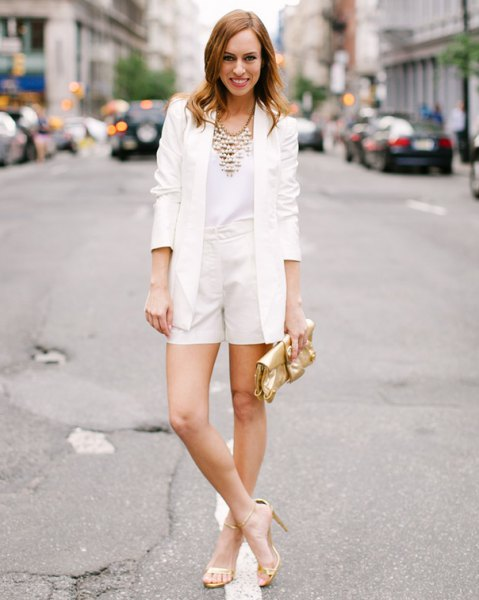 white blazer with mini shorts and gold sandals
