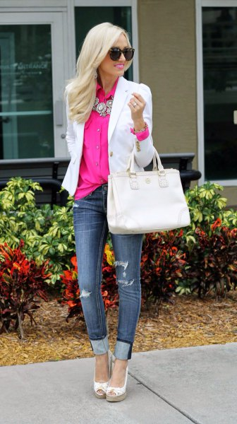 white blazer with pink shirt with buttons and dark blue jeans with cuffs