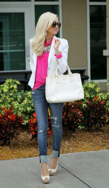white blazer with pink shirt with buttons and blue jeans with cuffs