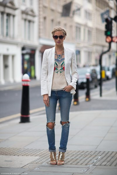 white blazer with pink graphic t-shirt and ripped jeans