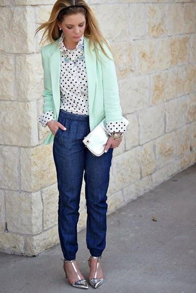 white blazer with a polka dot shirt and blue jeans