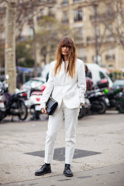 white blazer with slim-fitting trousers and black leather derby shoes