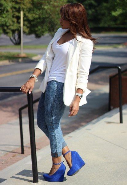 white blazer with V-neck and gray jeans