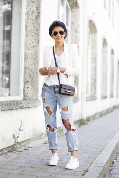 white blazer with a V-neck t-shirt and heavily ripped jeans