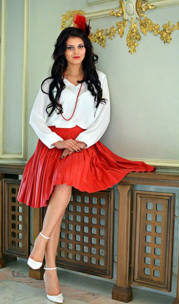 white blouse red pleated leather skirt