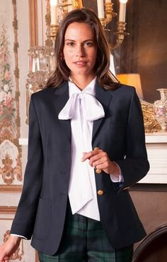 white blouse with black blazer and gray checked pants