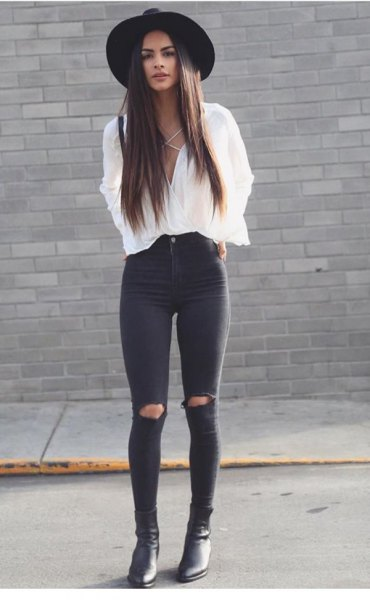 white blouse with black felt hat and ripped skinny jeans