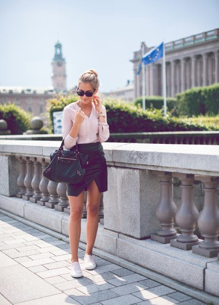 white blouse with black mini leather skirt and white canvas slip-on sneakers