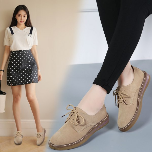 white blouse with black dotted mini skirt and light camel suede shoes