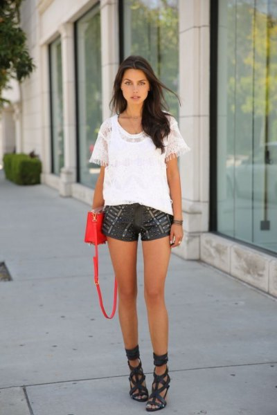 white blouse with black printed leather shorts