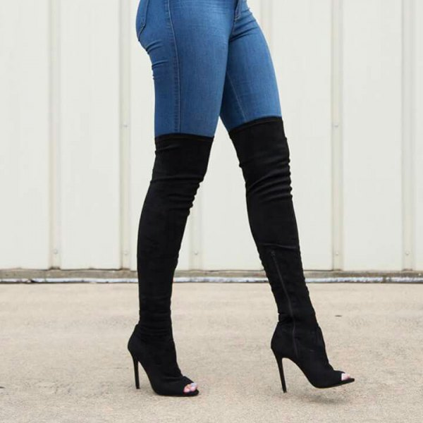 white blouse with blue jeans and black knee-high boots