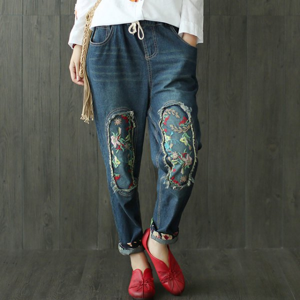 white blouse with dark blue embroidered, fleece-lined jeans