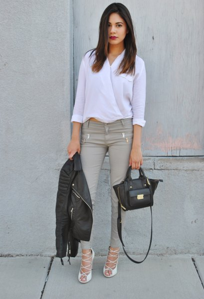 white blouse with gray skinny jeans and strappy heels