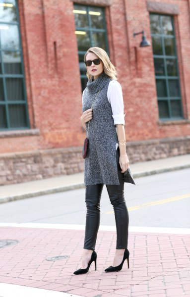 white blouse with gray turtleneck and leather gaiters