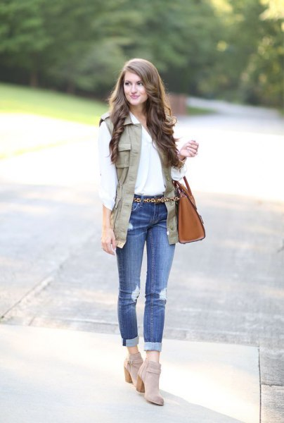 white blouse with a light brown vest and gray suede boots