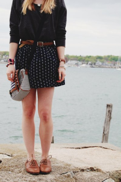 white blouse with mini printed skater skirt with belt and brown leather shoes