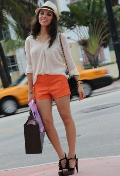 white blouse with straw hat and orange mini-shorts