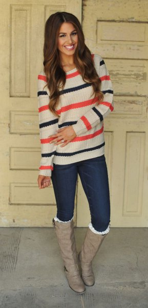 white blue and orange striped sweater with pink leather boots