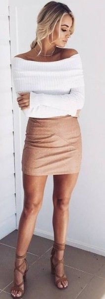 white, figure-hugging, ribbed sweater with boat neckline and figure-hugging mini skirt